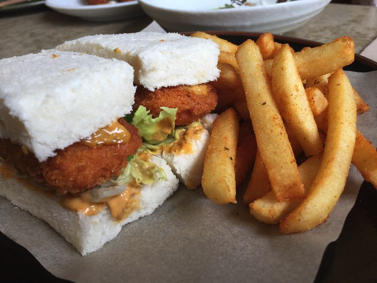 Image of Lucky Suzie prawn katsu sandwich with chips on side